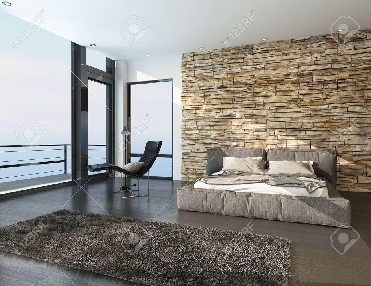 Moderne zonnige slaapkamer met uitzicht op de oceaan met een ...