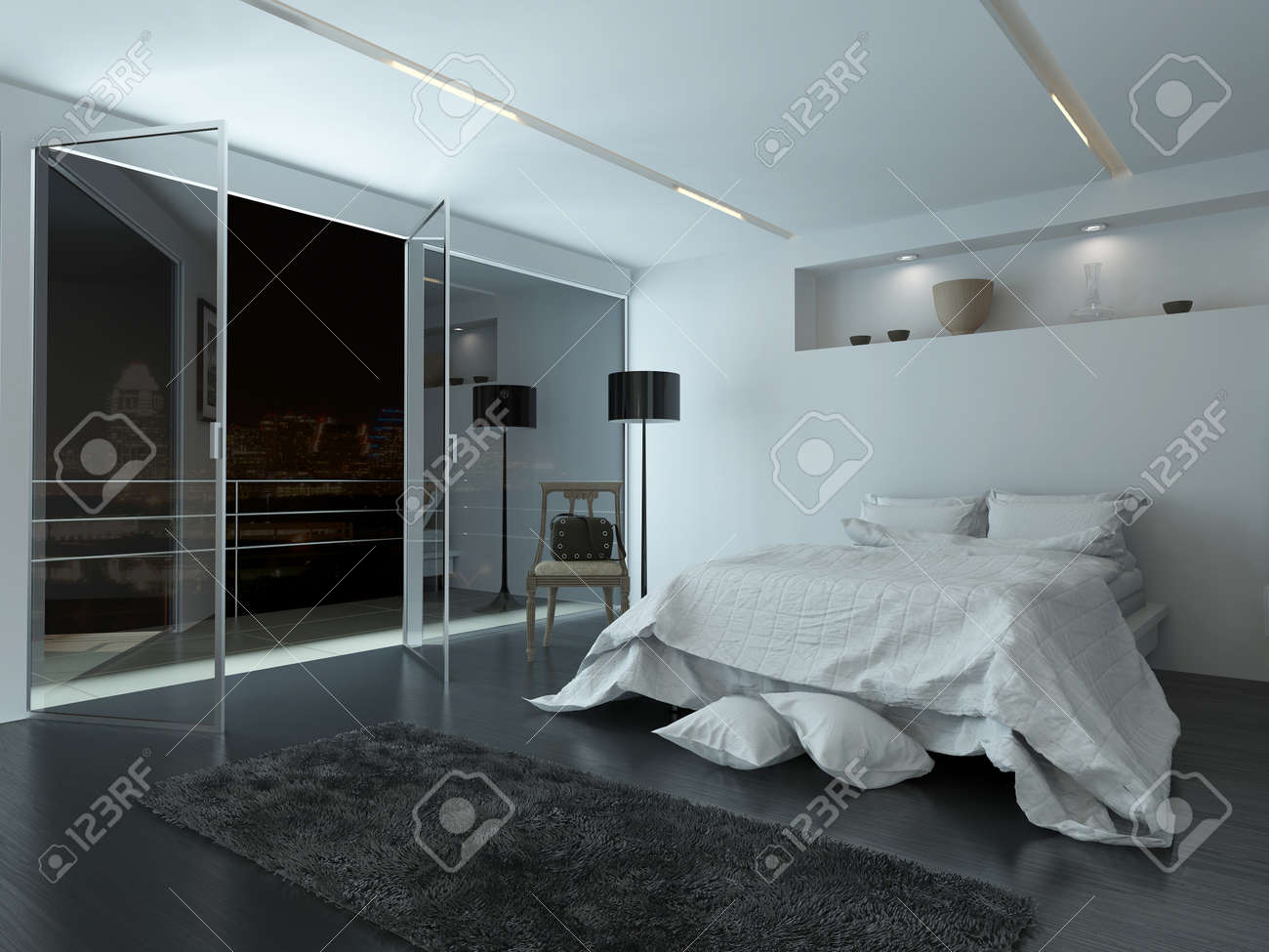 Elegant White Modern Bedroom Interior With Large View Windows Overlooking A Night Sky And Balcony Illuminated
