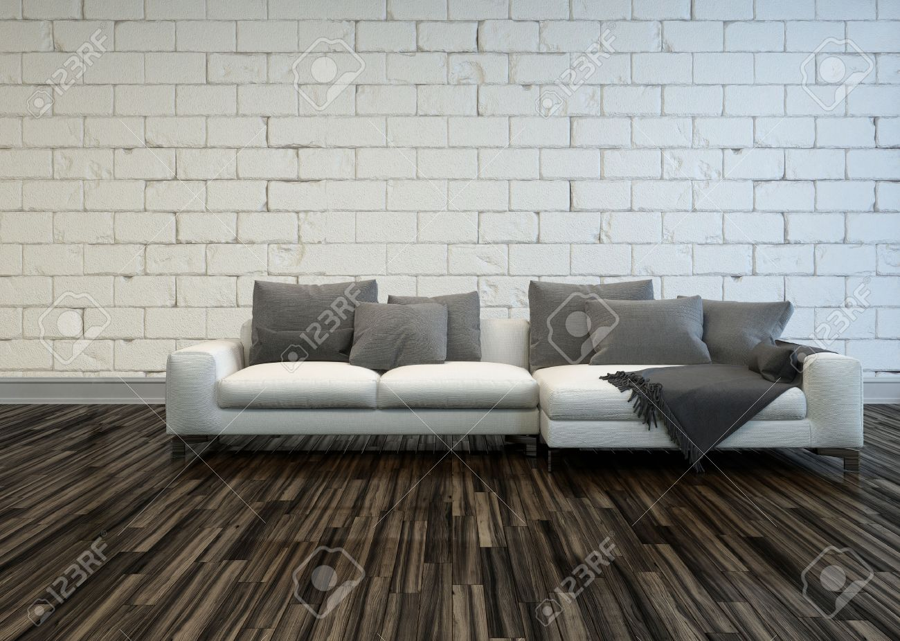 Rustic Living Room Interior With A Large White Sofa Grey Cushions On Bare Wooden