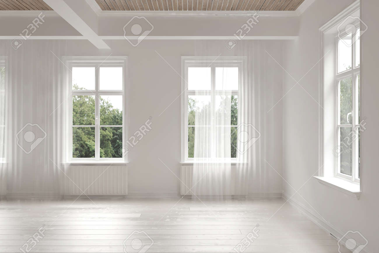 empty stark white monochrome spacious interior of a loft room surrounded by windows letting in bright