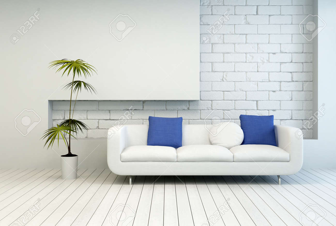 Fresh Green Plant Near White Couch With White And Blue Pillows ...