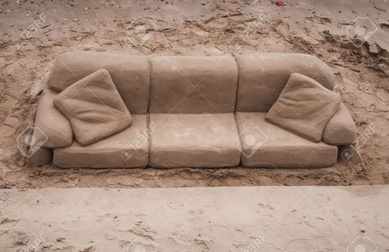 Exceptional Sand Sculpture Of A Sofa And Cushions Carved Out Of Golden Beach Sand On  The South