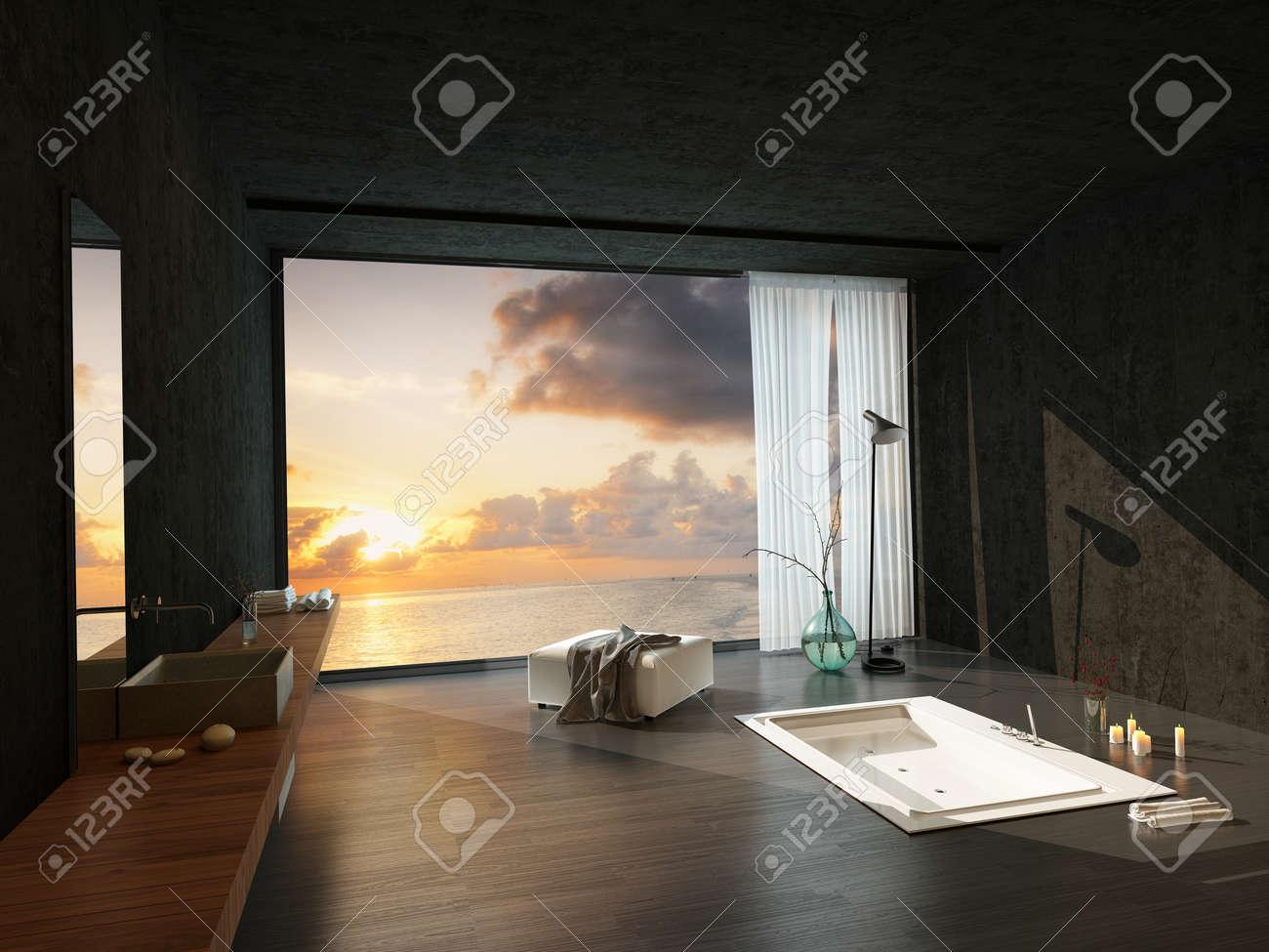 archivio fotografico vasca incassata in un bagno di lusso moderno con un tramonto colorato visibile attraverso la grande finestra
