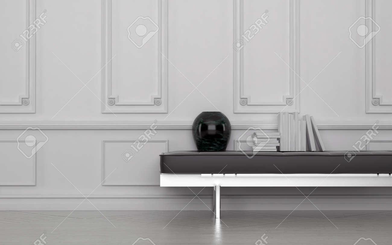 Zeitgenossische Schwarze Vase Und Stapel Bucher Auf Leder Bank In