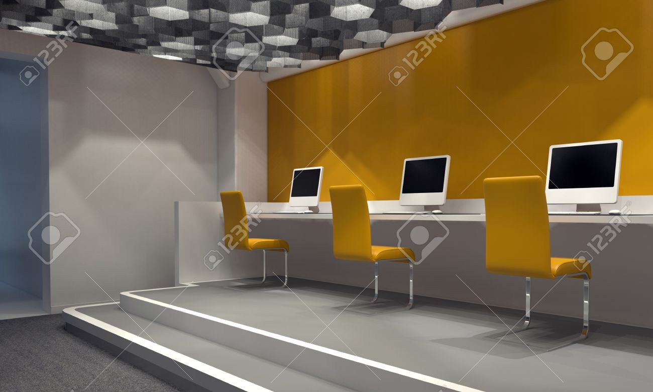 Contemporary Internet Cafe With A Feature Yellow Wall And A Row Of Computers  At A Counter