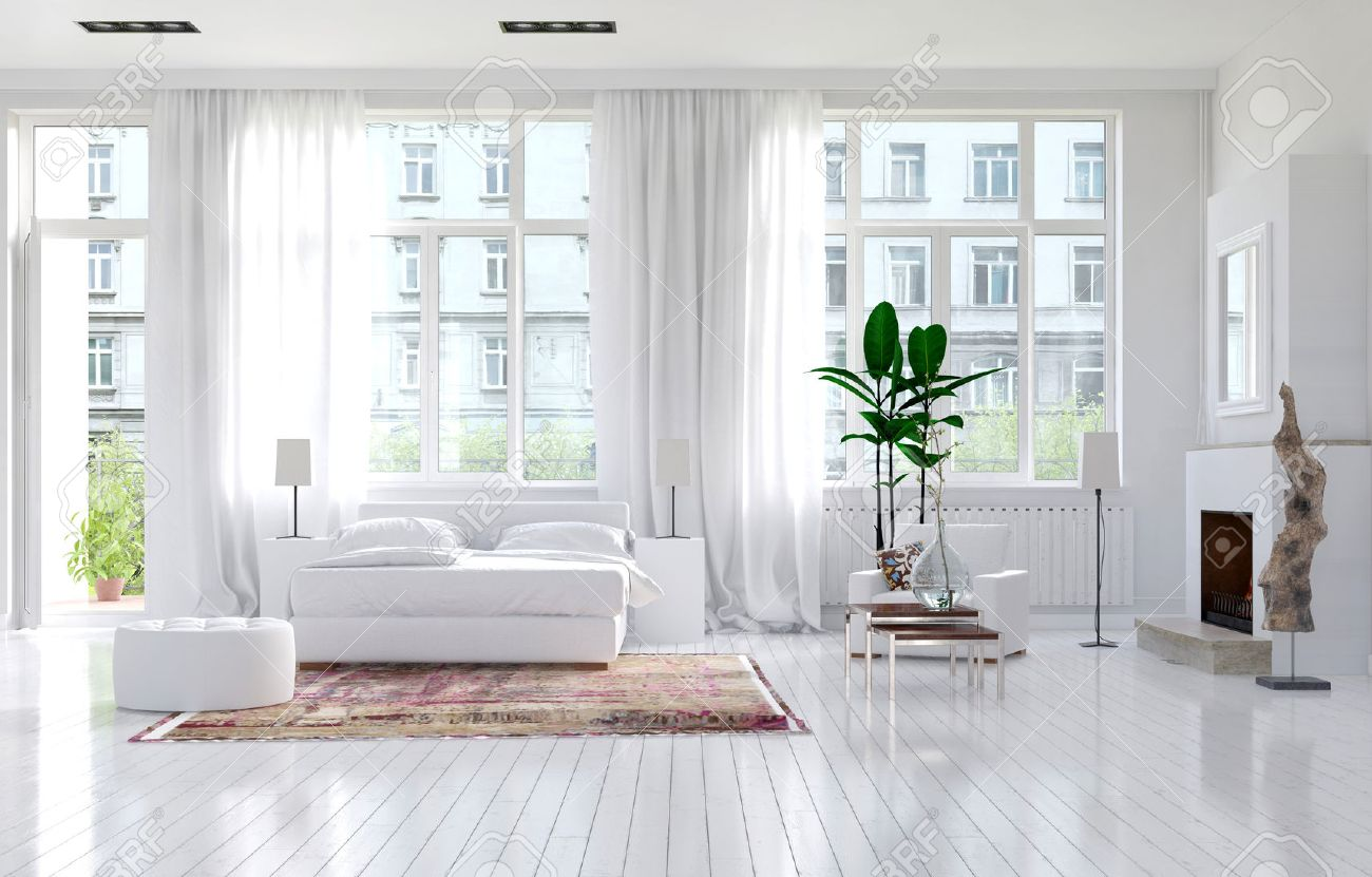 large spacious monochromatic white bedroom with fireplace a