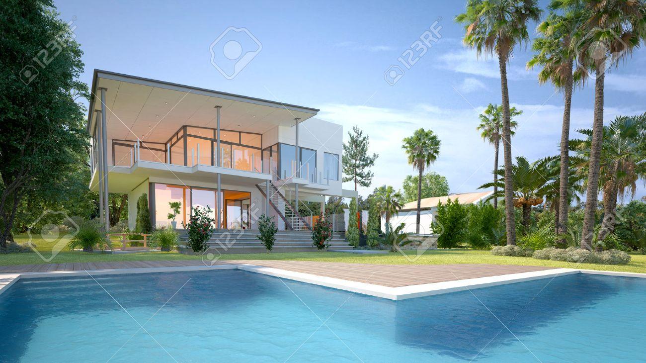 Maison blanche moderne de luxe ou une villa avec des murs angulaires et de  grandes fenêtres donnant sur un jardin tropical avec des palmiers et ...