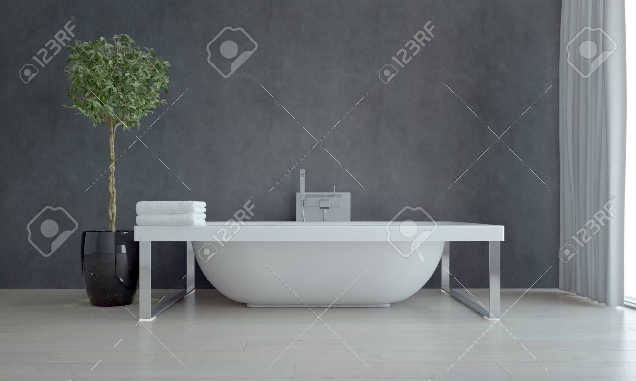 Elegante Weiße Badewanne Innerhalb Eines Einfache Moderne Badezimmer Mit  Einer Grünen Pflanze Dekoration Gegen Graue Wand