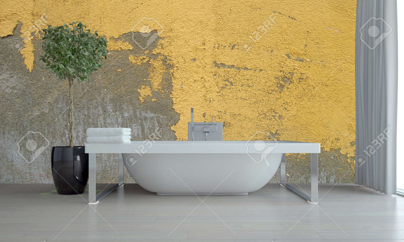 Bathroom Interior With Feature Grunge Yellow Wall With Peeling Flaking  Paint And A Freestanding Bathtub With