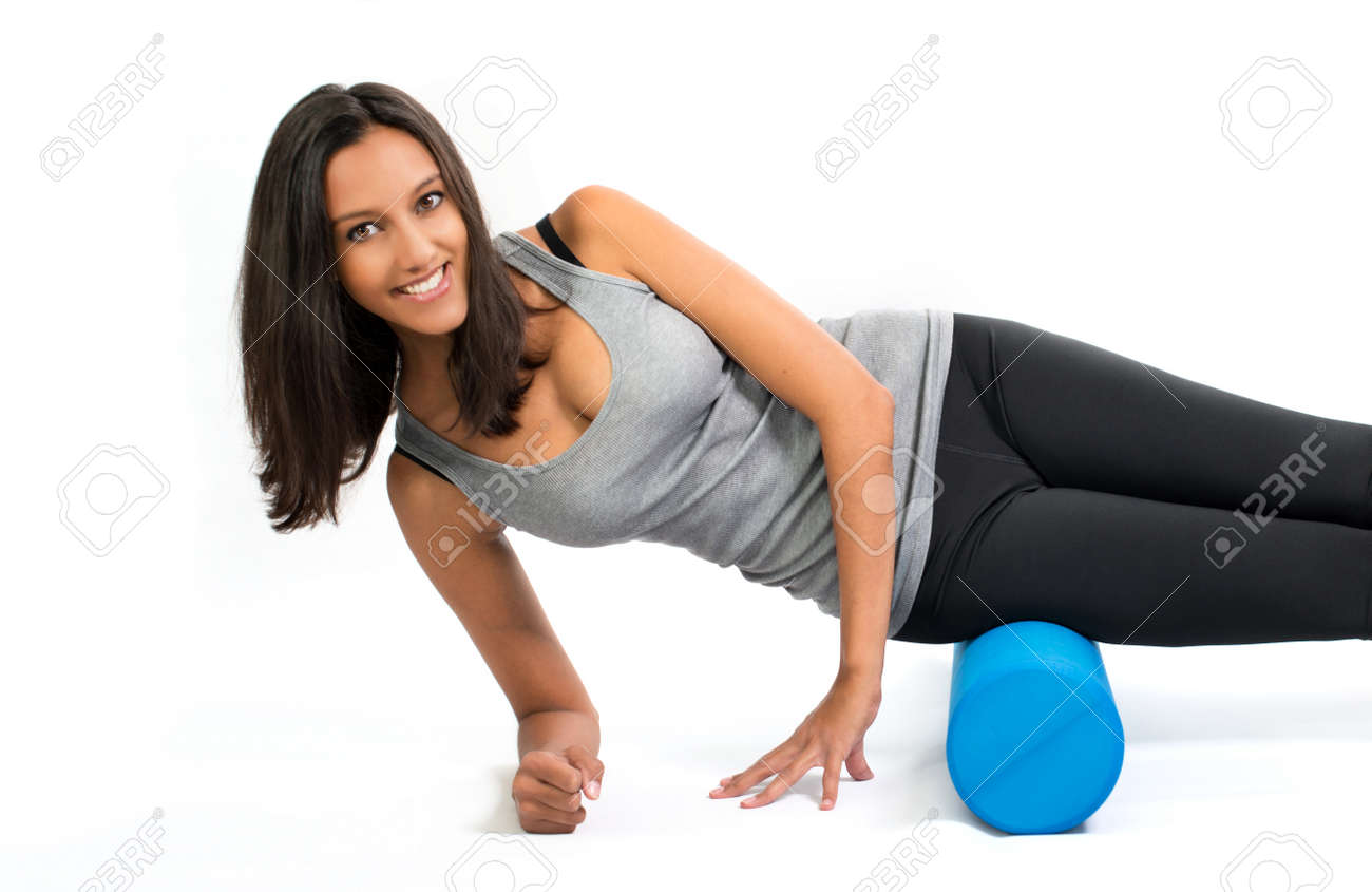 Young woman doing Fascia Muscle Training with a Fascia Roll. Fascia Training describes movement exercises that attempt to improve the functional properties of the muscular connective tissues. Standard-Bild - 46059634