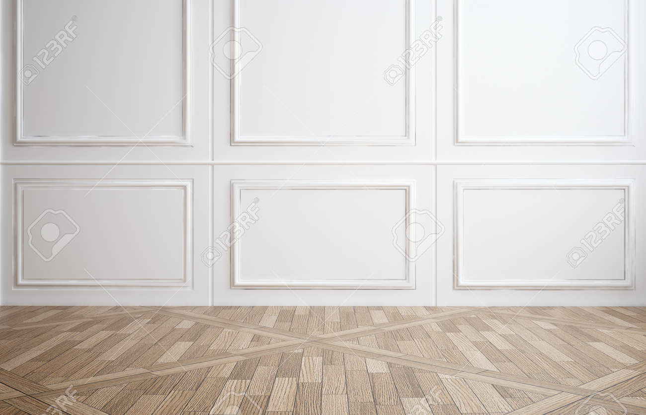 Empty room with classic white wood paneling on the walls and a hardwood parquet floor for