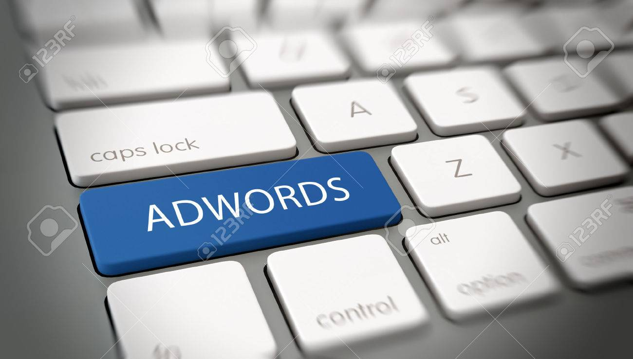 Adwords online advertising concept with white text - Adwords - on a large blue enter key on a white computer keyboard viewed obliquely at a high angle with blur vignette Standard-Bild - 48326265