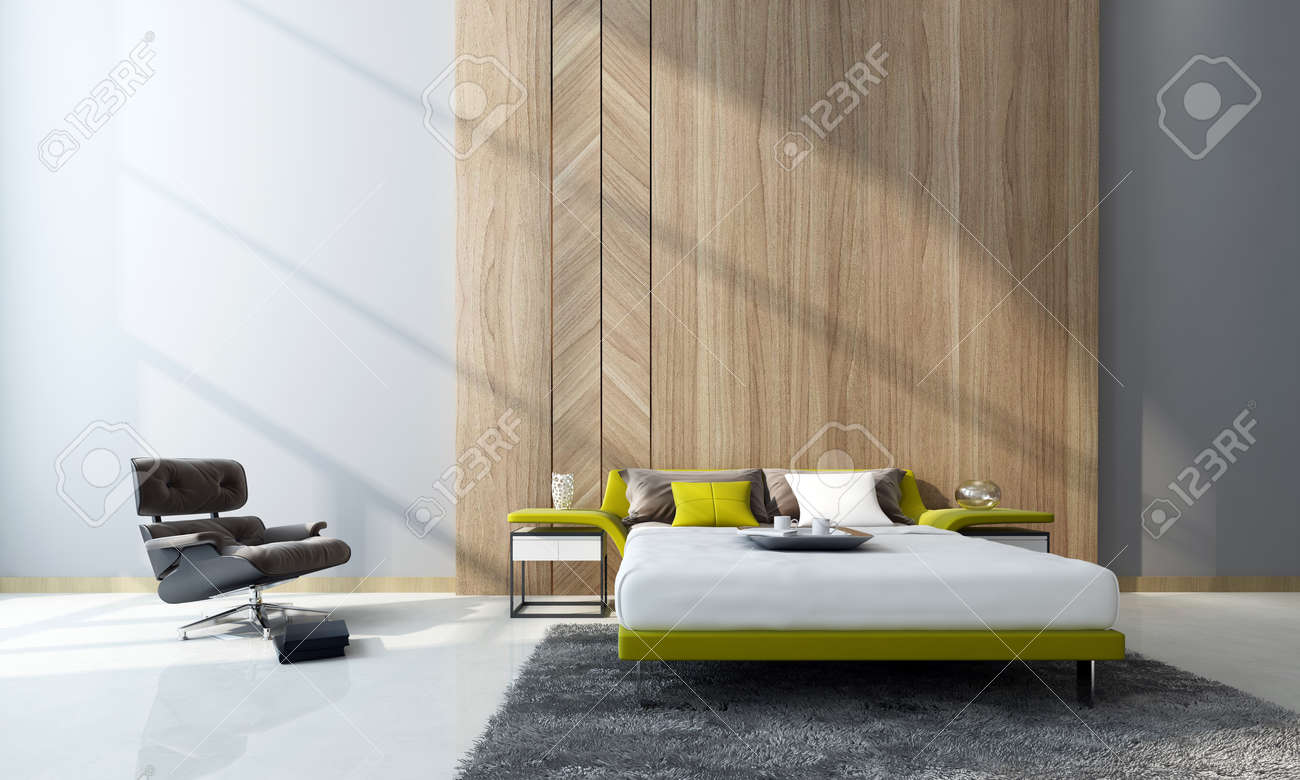 Contemporary bedroom interior with a double divan bed and cabinets in front of feature wood paneling and a comfortable armchair in a double-volume room. 3d Rendering. Standard-Bild - 50429179