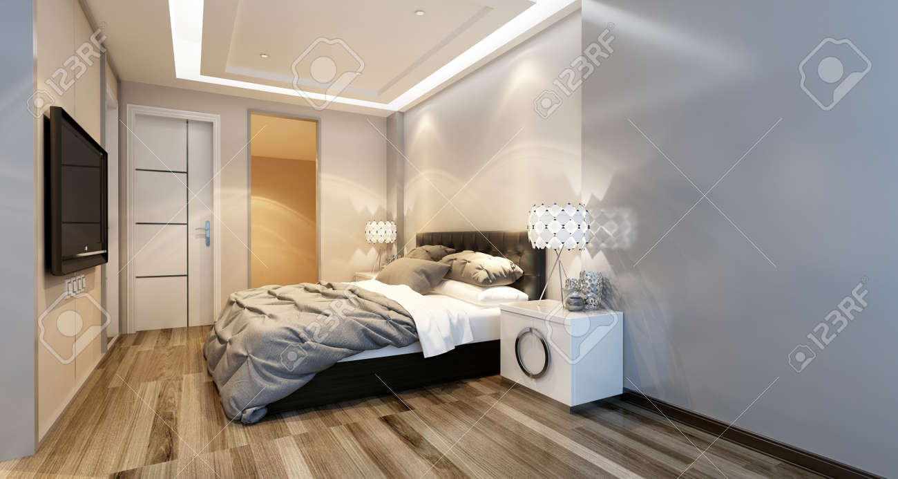 Modern Bedroom Interior With Overhead Lighting And A Stylish Bed Facing A  Wall Mounted Television In
