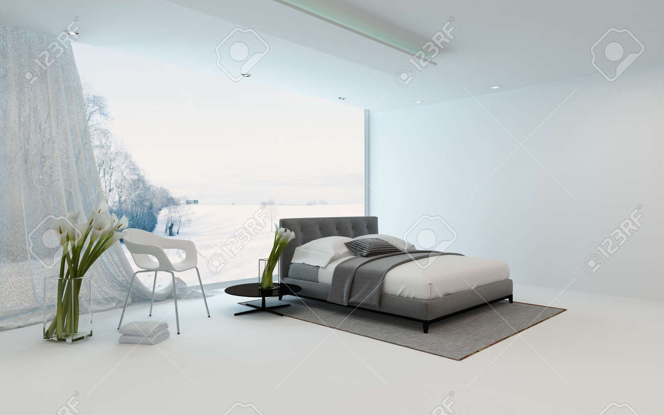 modern cool bedroom interior with fresh arums and a double bed