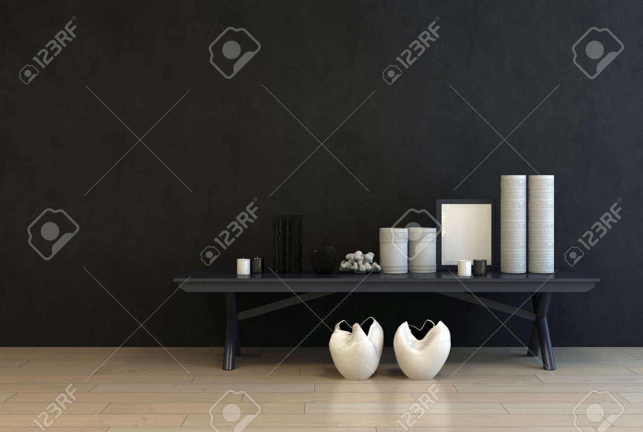 Display of modern ceramics and an empty picture frame on a low black table against a black wall for a dramatic modern interior decor with copy space, 3d rendering Standard-Bild - 52465915