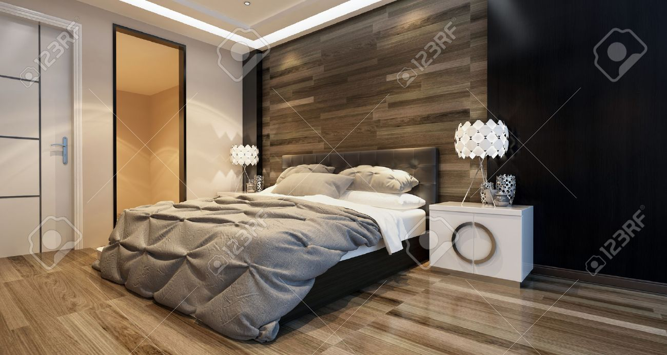 Modern bedroom interior with overhead lighting and a stylish bed in front of a wooden wall in a luxury home. 3d Rendering. Standard-Bild - 52467963