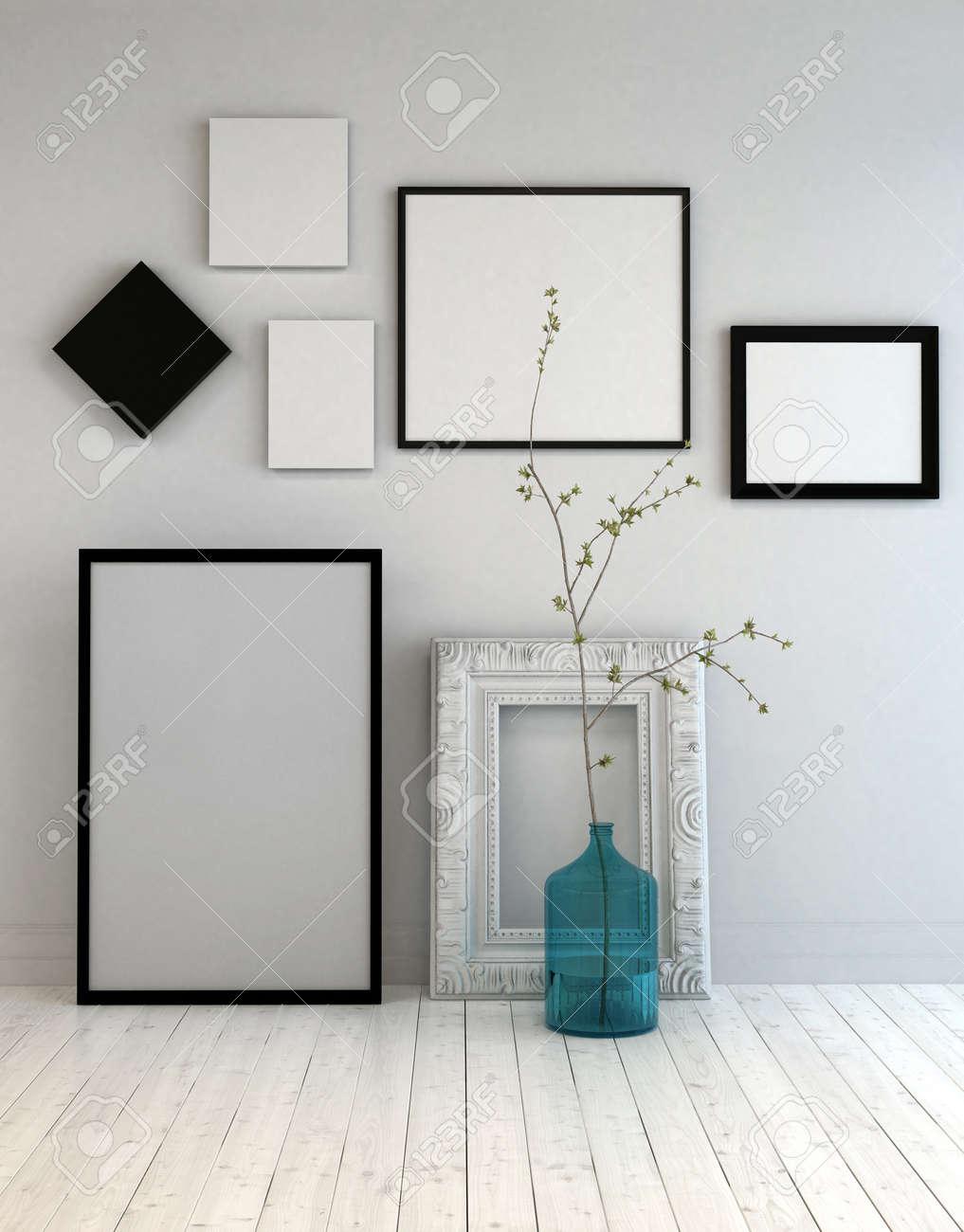 Assortiment de différents image vide cadres sur un mur gris clair au-dessus  d\'un blanc parquet peint rustique avec une bouteille en verre bleu et ...