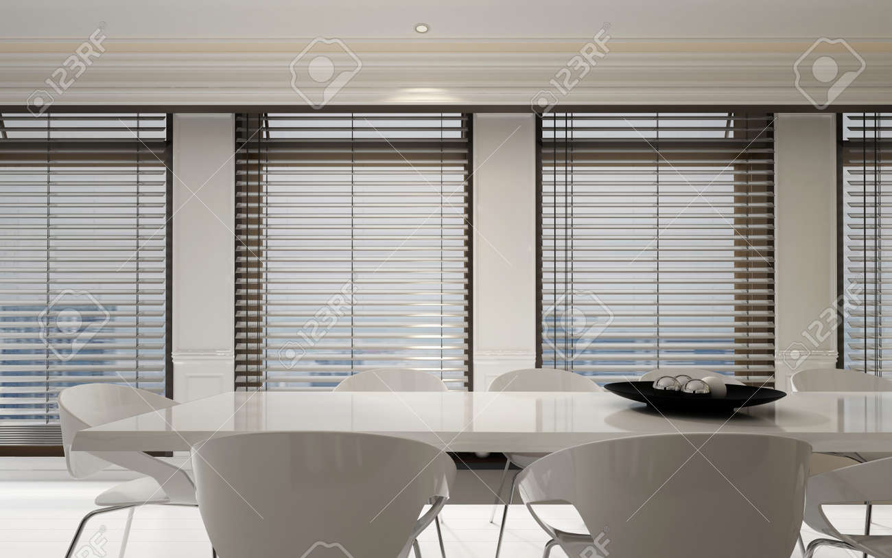 Stijlvol wit eetkamer suite in een lichte interieur met een rij van grote  ramen met jaloezieën in een ruime monochromatische kamer, 3D-rendering