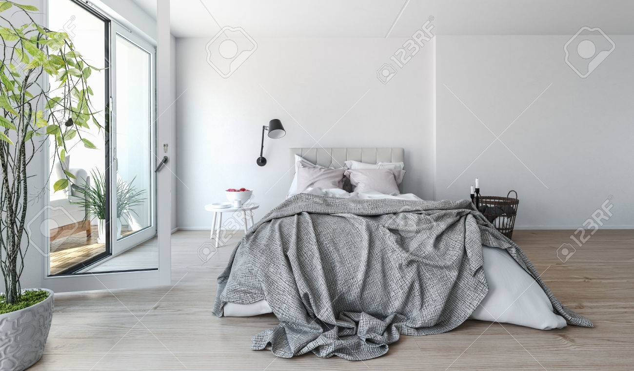 modern bedroom interior with rumpled bedclothes on a double bed