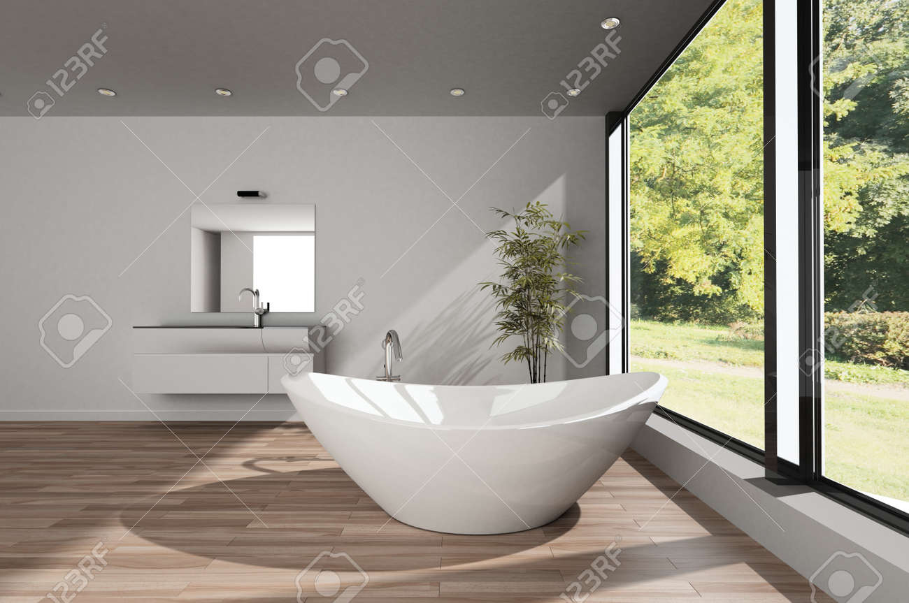 Modern spacious minimalist bathroom with a large boat shaped bathtub on a wood floor with vanity