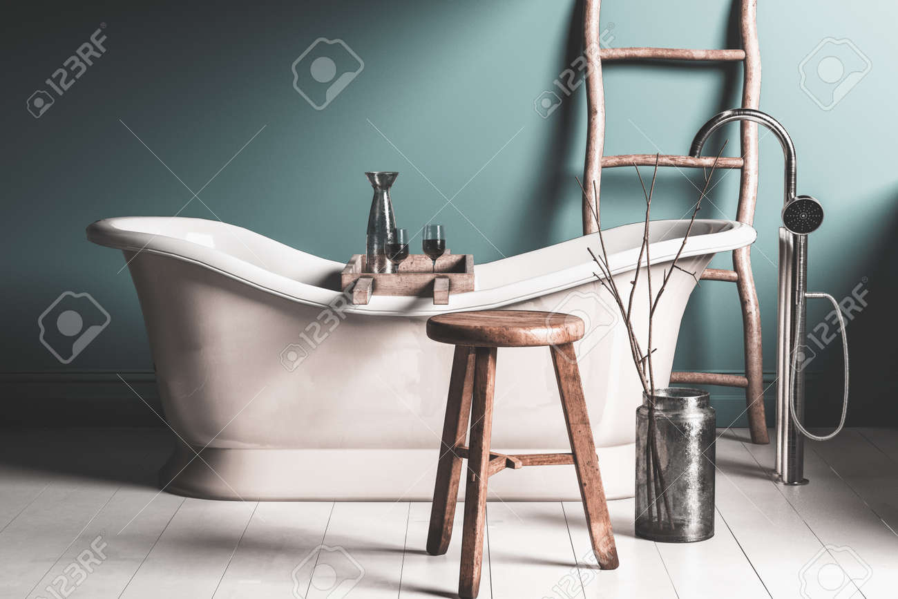 Old Roll Top Chateau-style Bathtub In A Rustic Bathroom With.. Stock ...