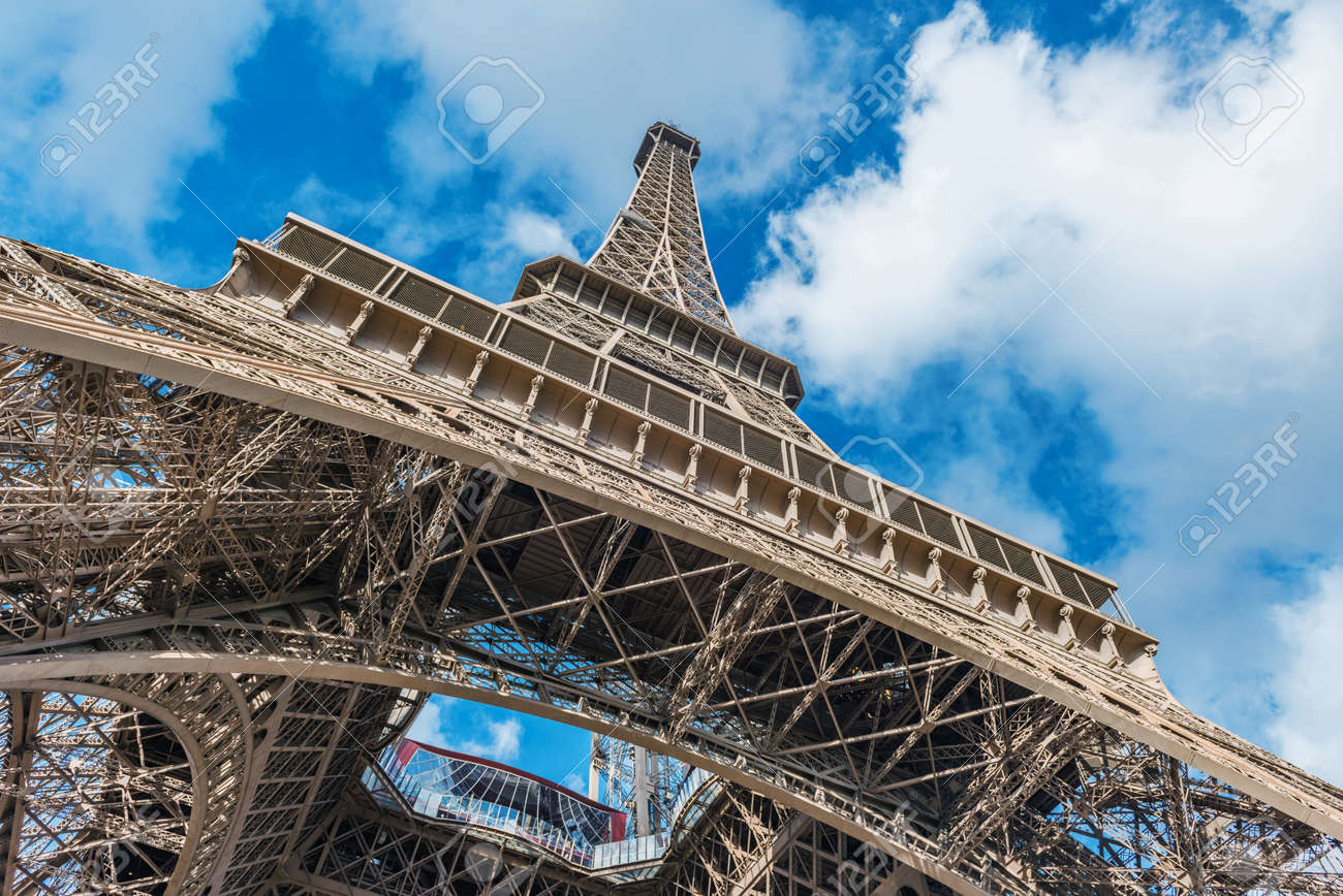 Low angle view of Eiffel Tower against clouds in sky, Paris, France - 128882096