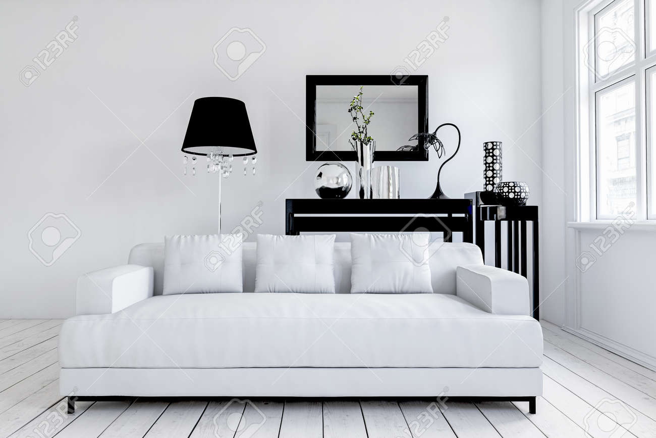 Wide white couch in front of black floor lamp and table underneath rectangular mirror in black frame. 3d rendering - 130167287