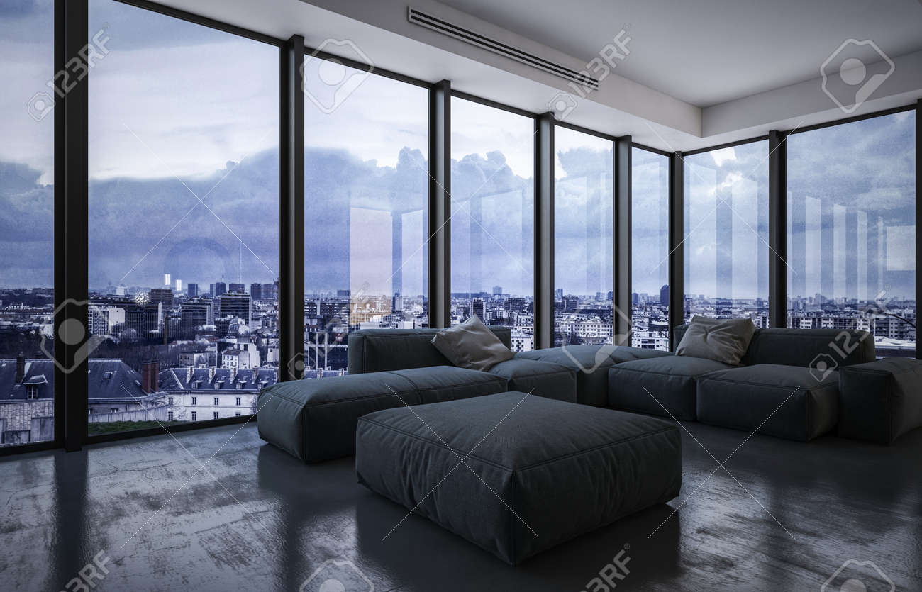 Spacious living room with large upholstered grey furniture on a dark floor with wraparound floor to ceiling glass windows overlooking a city at dusk with clouds. 3d rendering - 130167293