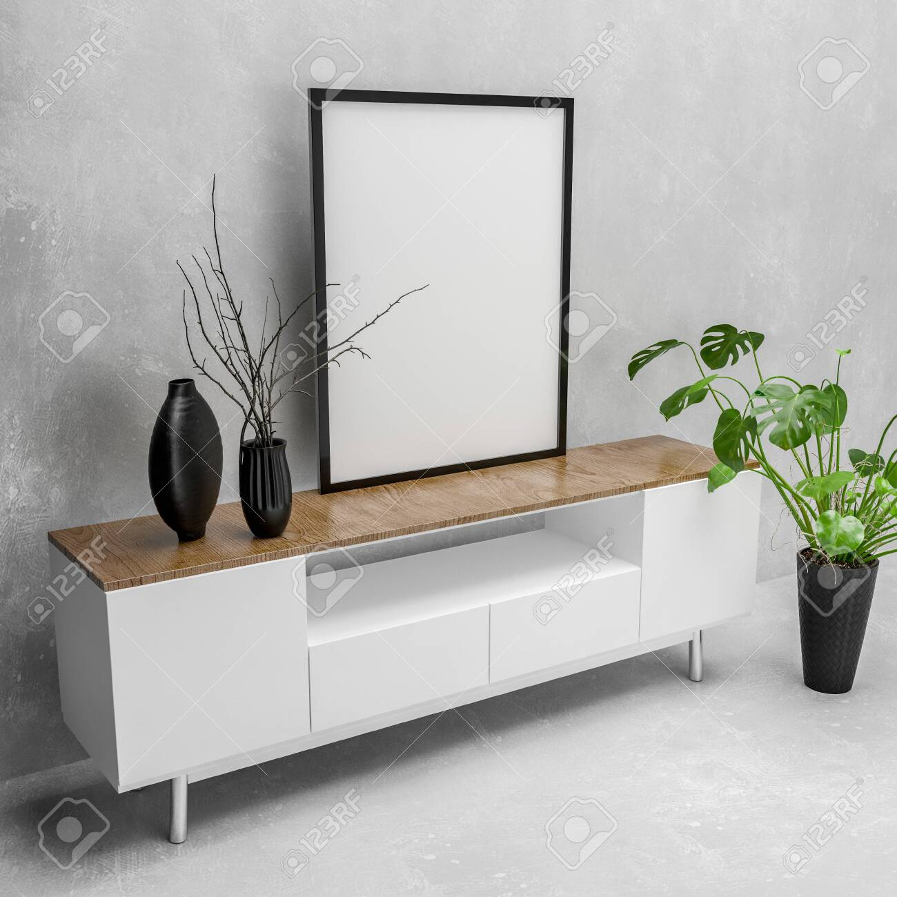 Modern white cabinet with blank picture canvas in a simple black frame on top and houseplant in a monochromatic white living room. 3d rendering - 130167296