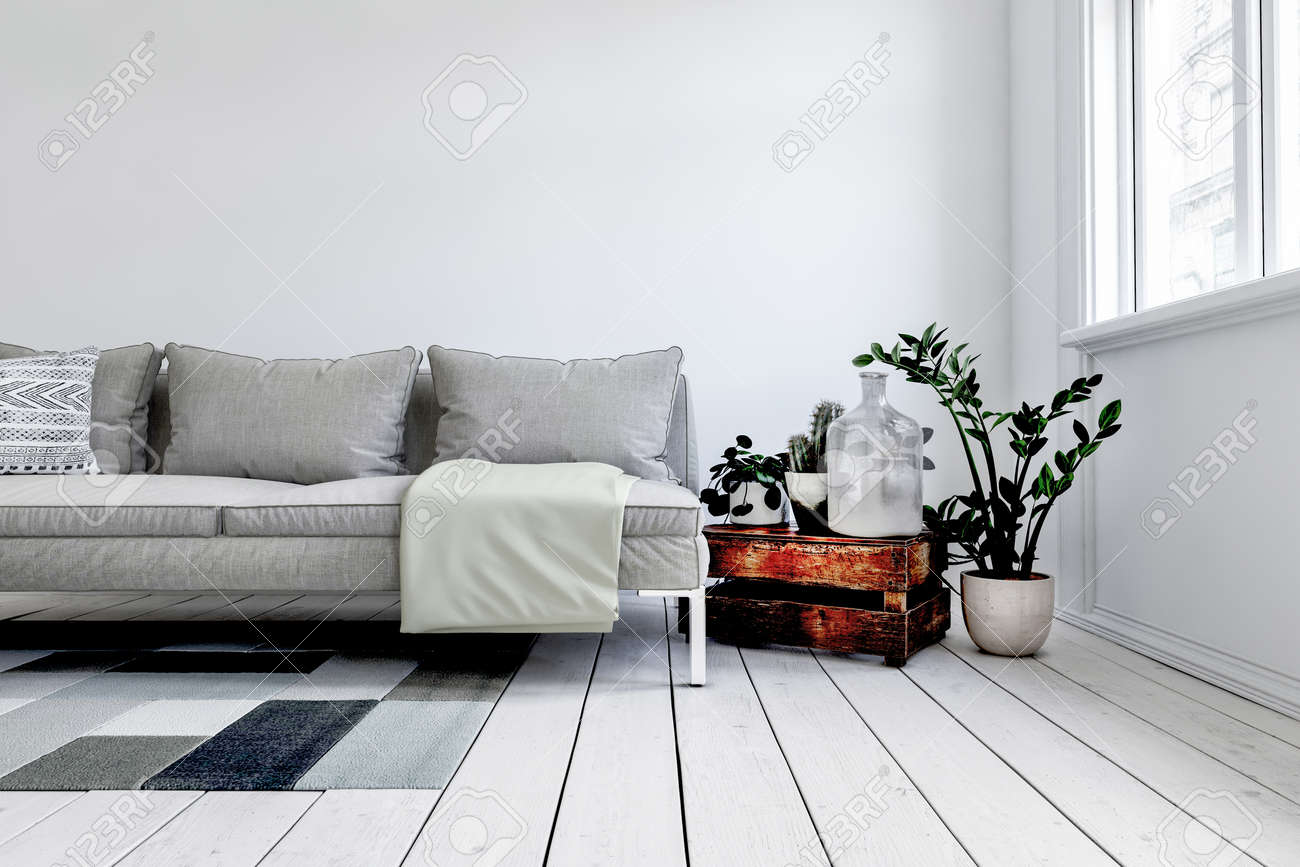 Digital render of modern grey couch in front of white wall next to rustic wood crate and small plant in pot. 3d rendering - 130167300