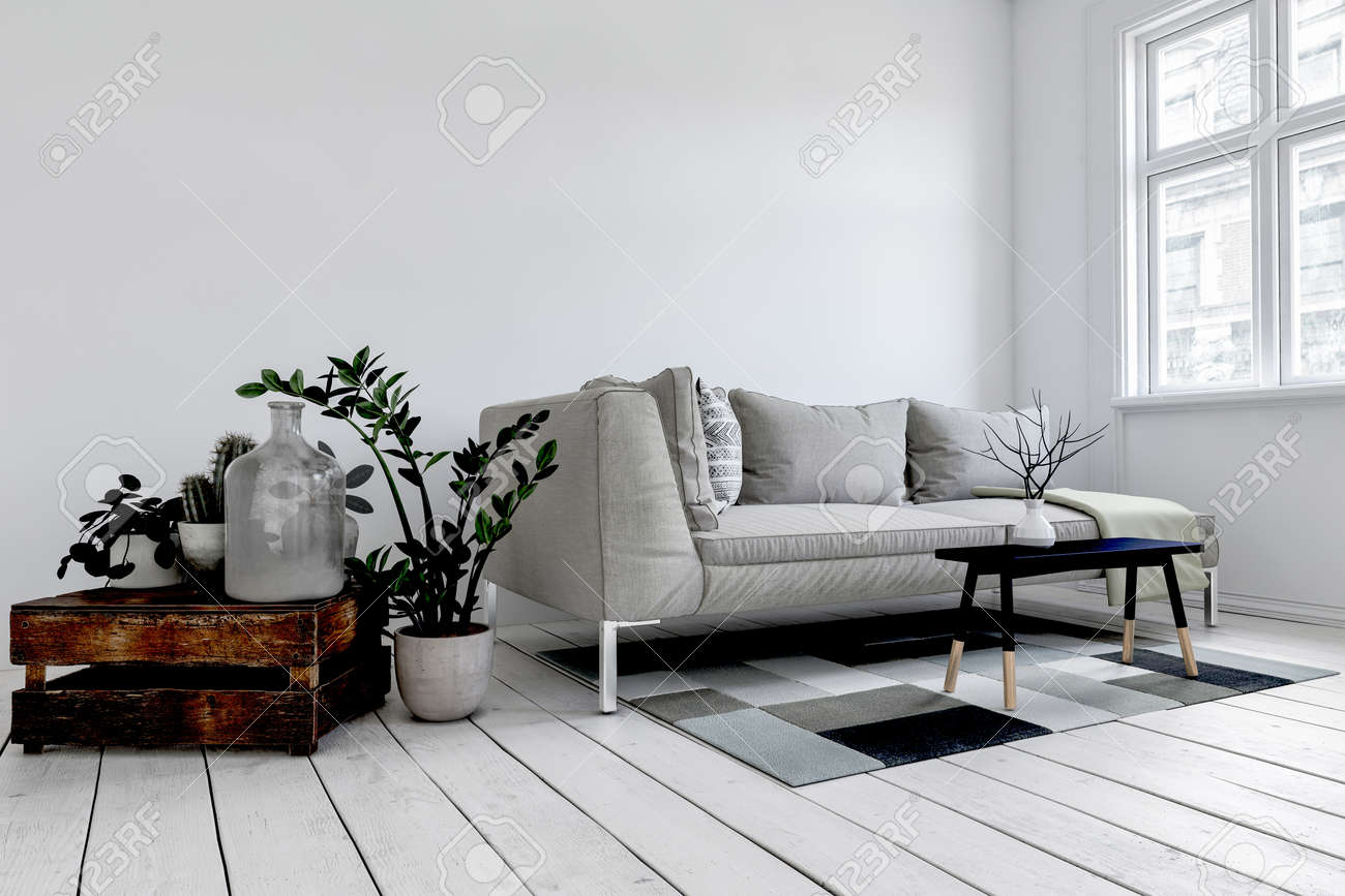 Grey couch behind small black coffee table atop white floorboards and square rug in luxury living room - 130167319