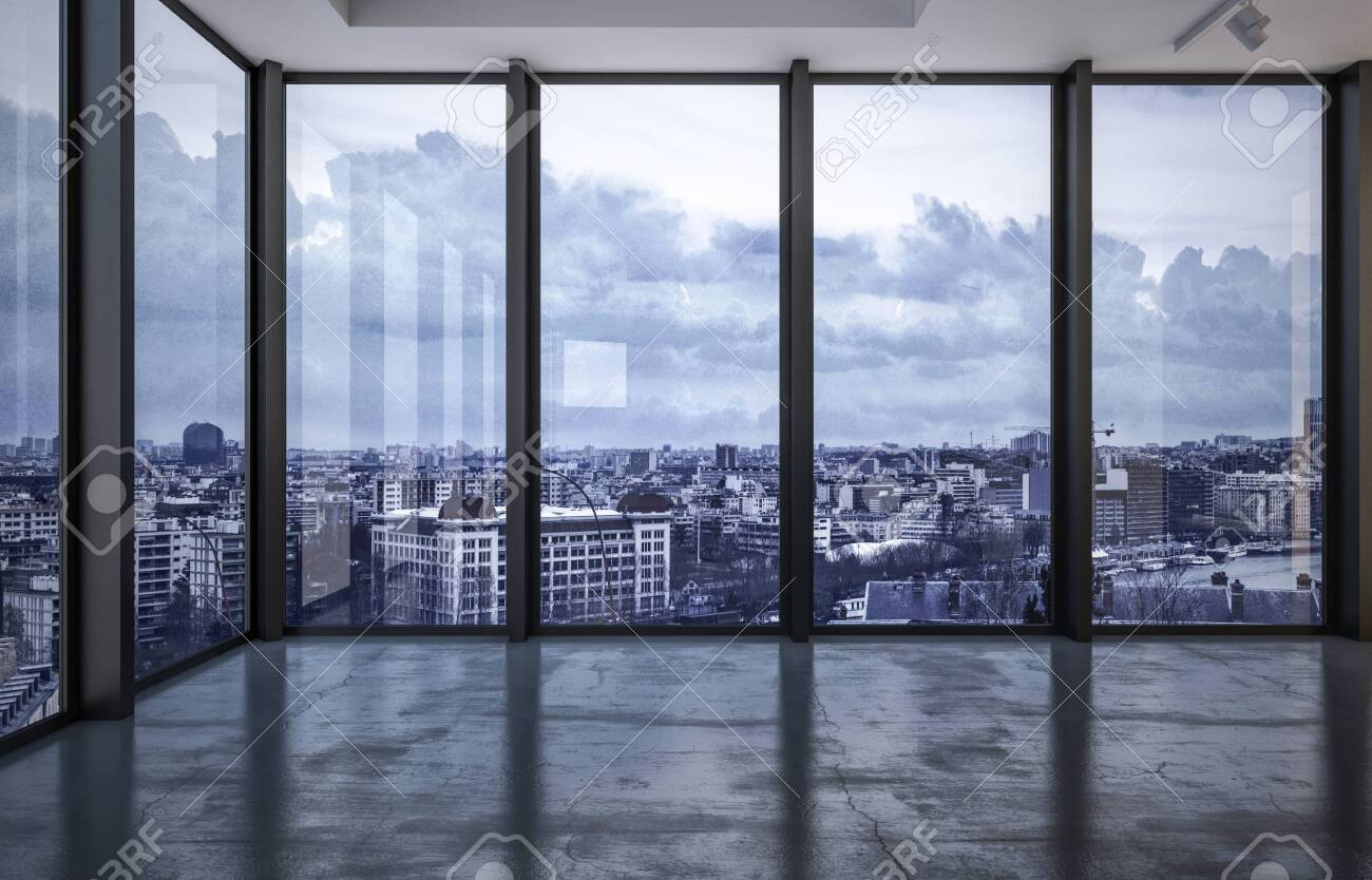 City rooftops viewed through wraparound floor to ceiling windows in a spacious empty room with grey floor in evening light with a cloudy sky. 3d rendering - 130167320