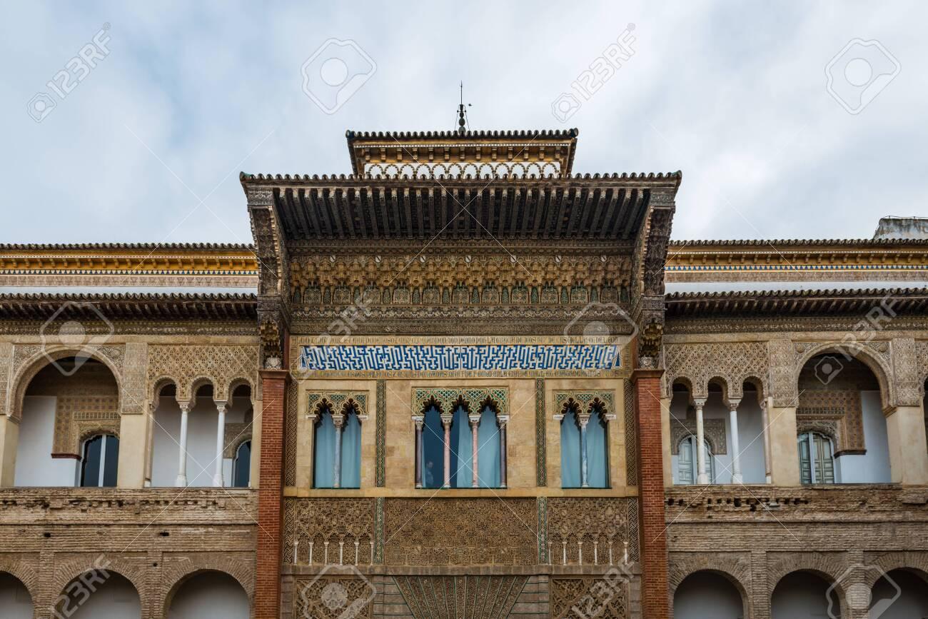 SEVILLE, SPAIN - December 09 2019: Exterior facade of the Patio de la Monteria courtyard in the Real Alcazar, Seville, Spain a Unesco listed World Heritage Site - 144093568