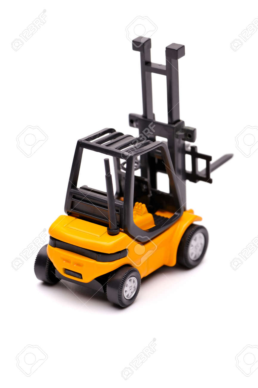 Yellow toy forklift on a white background Stock Photo - 8100737