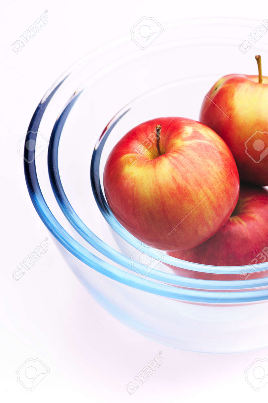Three apples in a three round glass bowls Stock Photo - 8100928