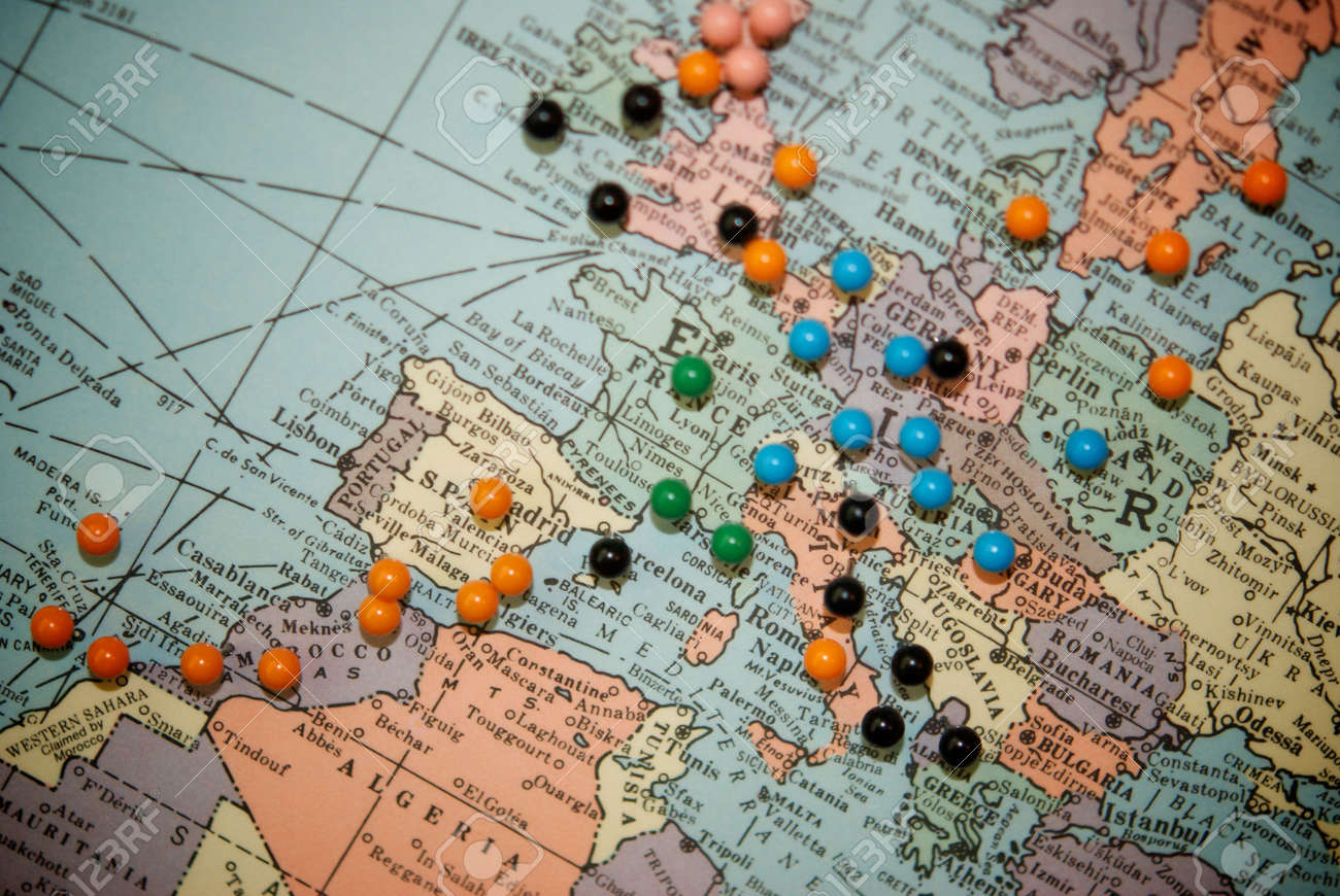 stock photo travel map with push pins with focus centered on central europe