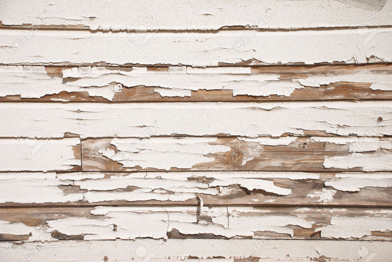 A very old wooden slat wall with serverly distressed and cracked paint - 7056750