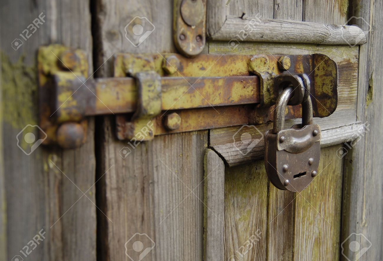 The Old Metal Lock Hanging At The Door Stock Photo Picture And
