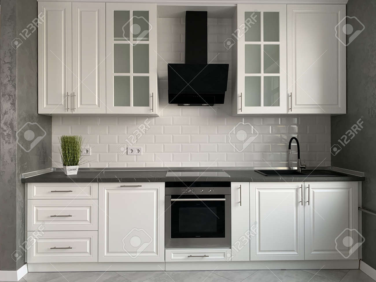 White Kitchen Furniture With Black Countertops New Modern Kitchen Stock Photo Picture And Royalty Free Image Image 138045188