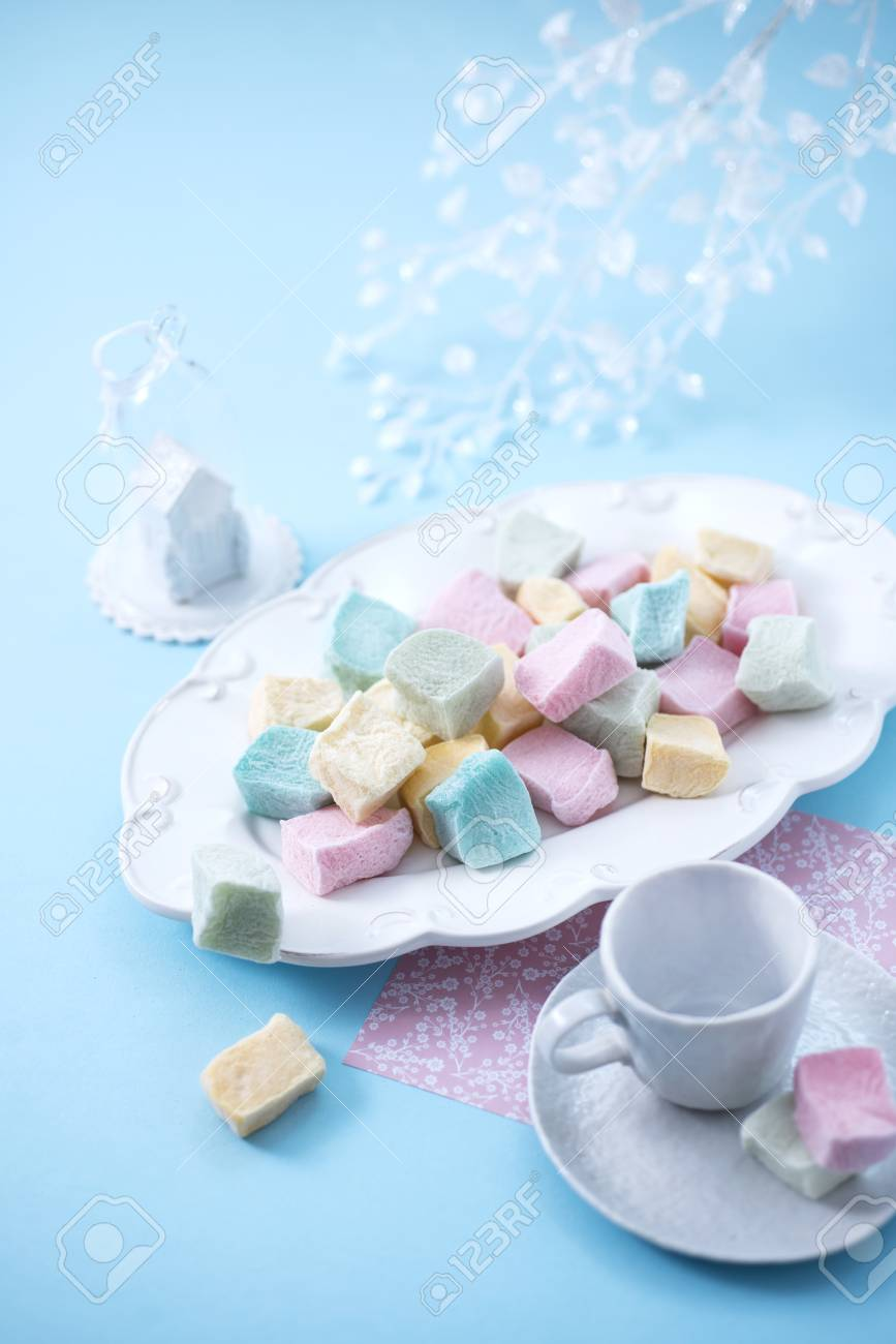 Marshmallows on a blue background, top view - 90368336