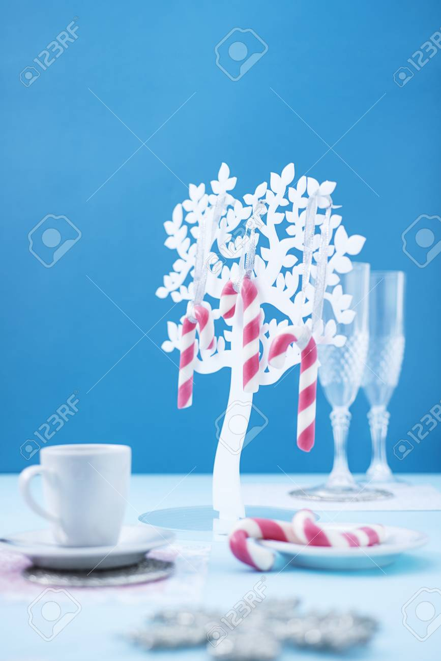 Candy canes on blue background. - 90142320