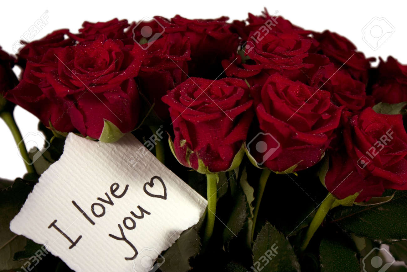 A Bunch Of Roses In Glass Vase With Note I Love You Stock Photo