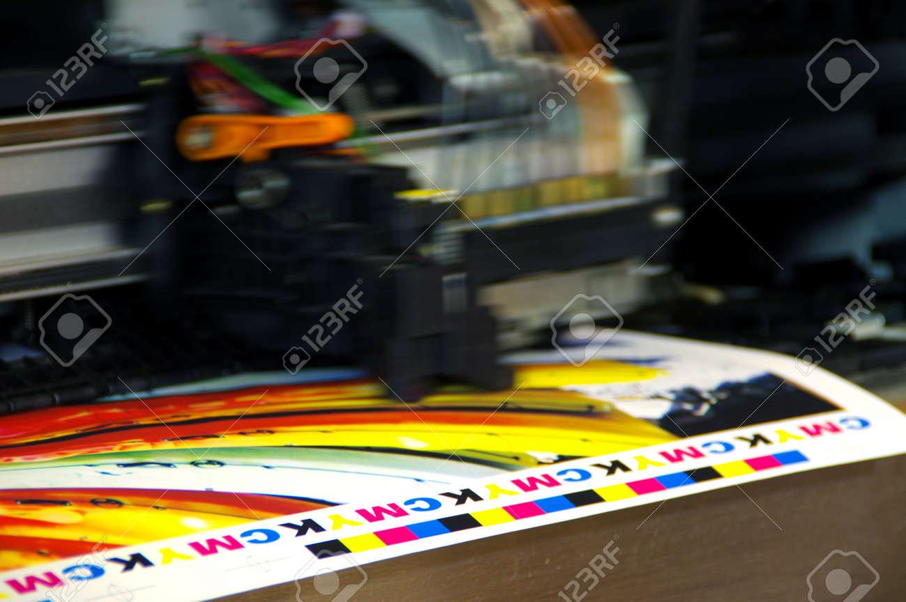 Inkjet printer plotter head moving over CMYK mark on white paper. Large digital printing machine. - 93886995