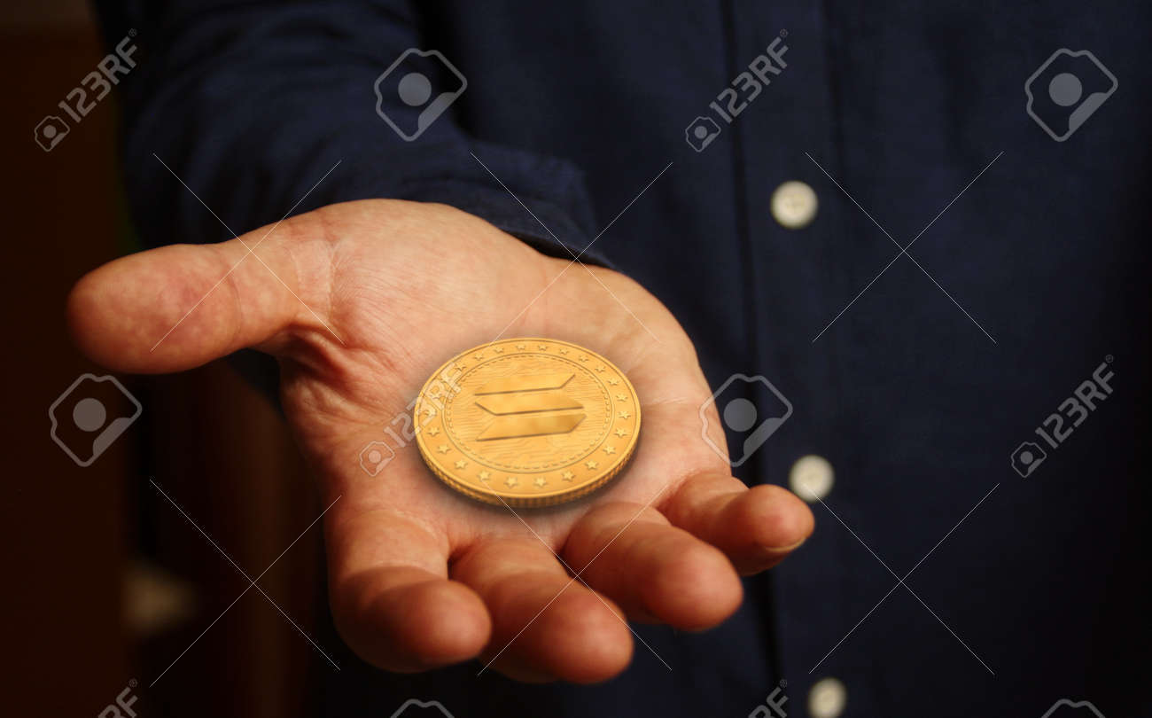 Solana altcoin cryptocurrency symbol golden coin in hand abstract concept. - 169697868
