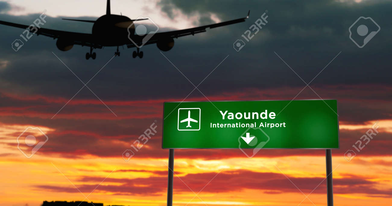 Airplane silhouette landing in Yaounde, Cameroon. City arrival with airport direction signboard and sunset in background. Trip and transportation 3d concept. - 170077012