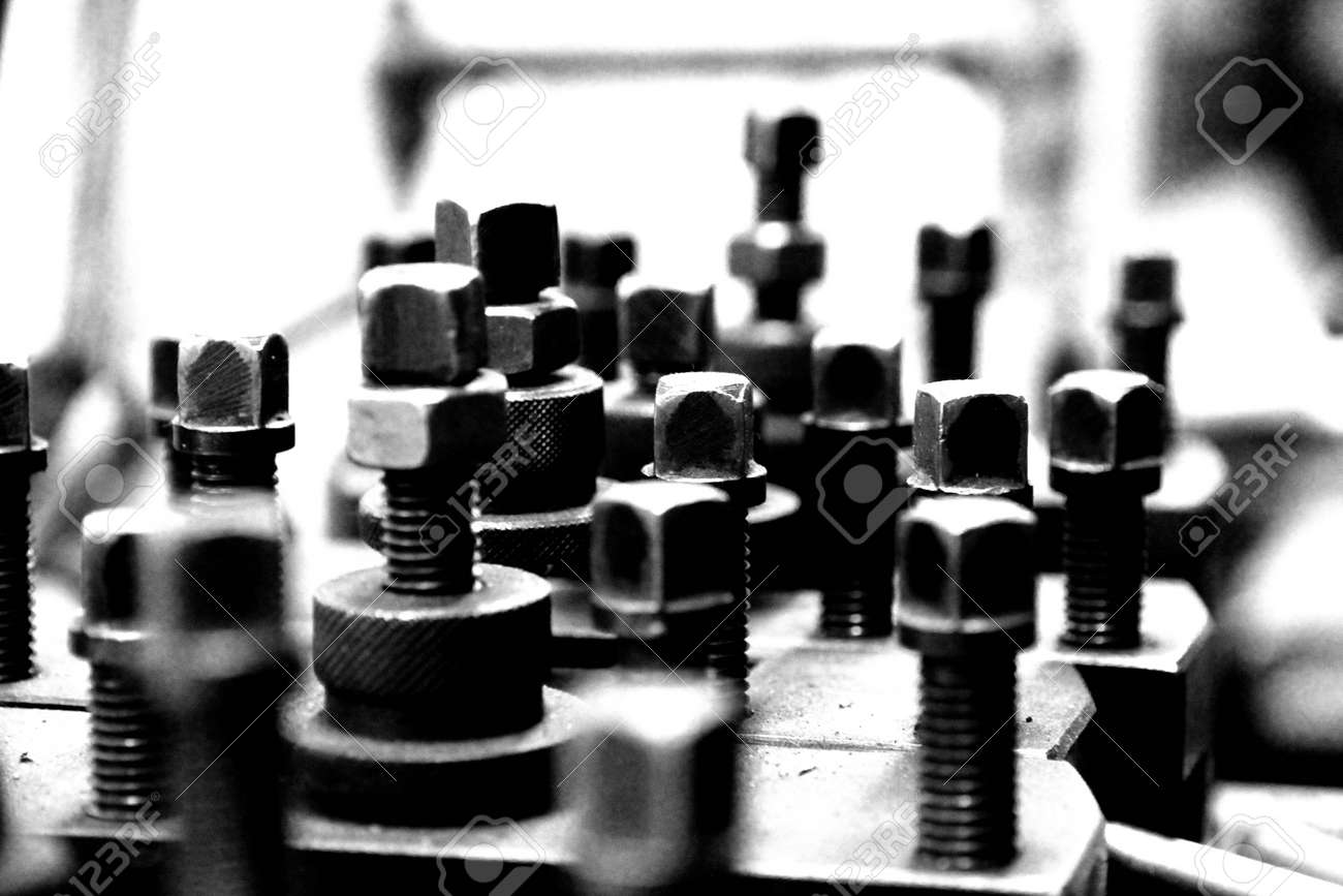 dirty artistic vintage grunge nuts and bolts in black and white Stock Photo - 11034777