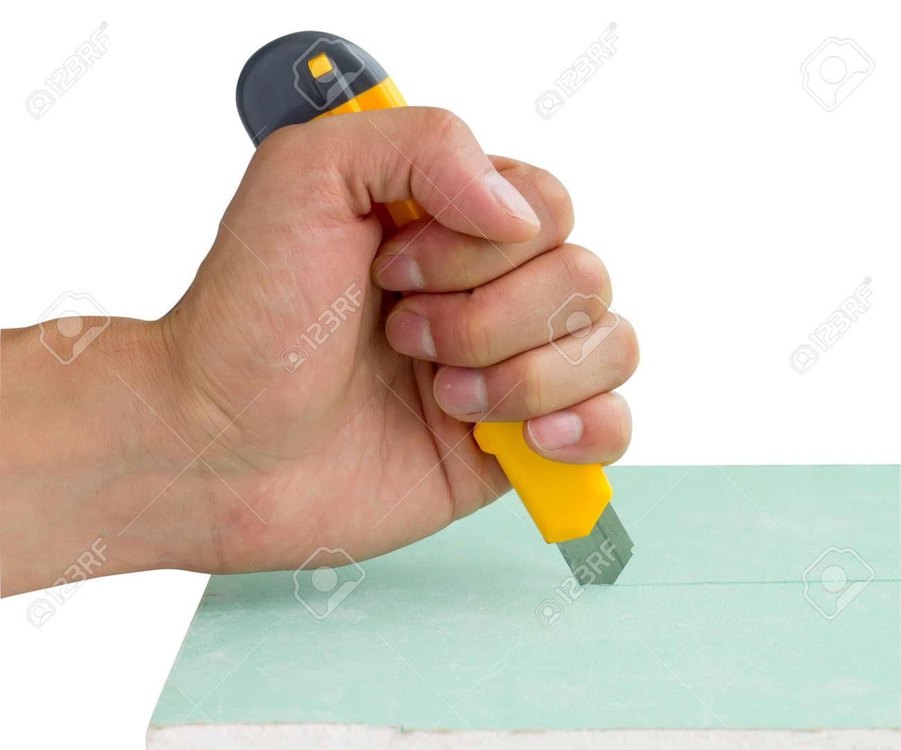builder cutting plasterboard Stock Photo - 15200723
