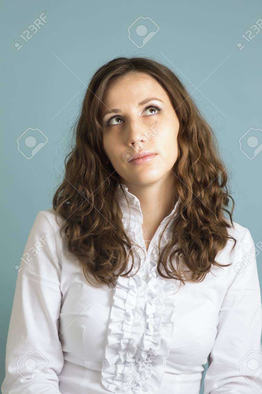 Young confused woman trying make a decision Stock Photo - 18359364