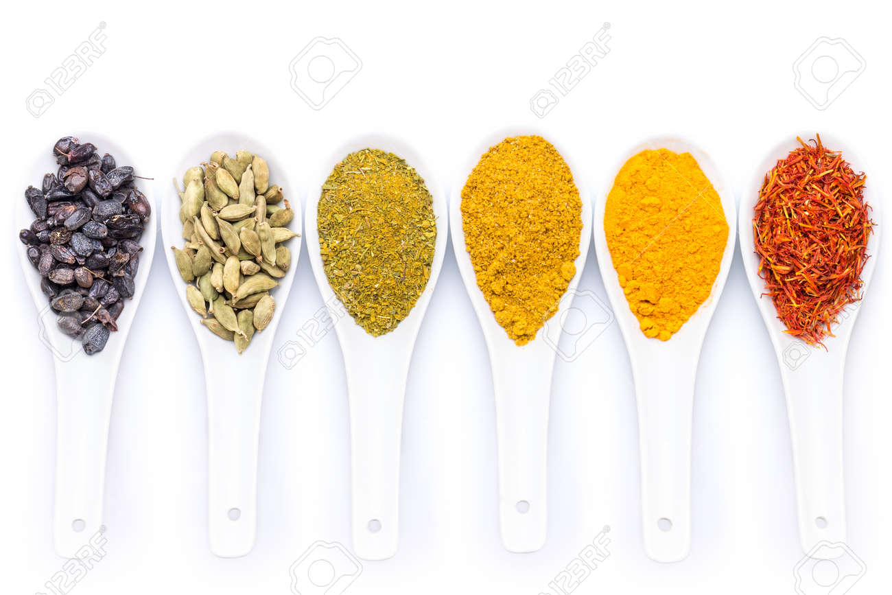 Diverse of spices in ceramic spoon isolated on white background - 32493978